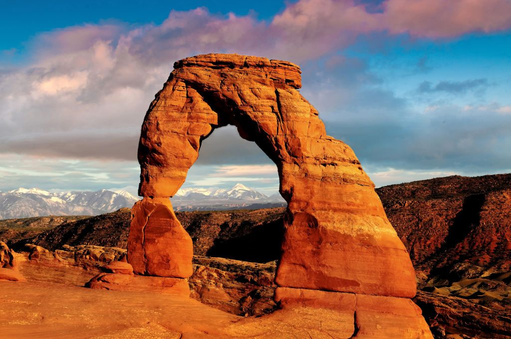a delkicate arch as the sun rises in Moab
