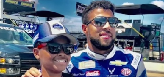 Bubba Wallace and young fan Harper Lucas.