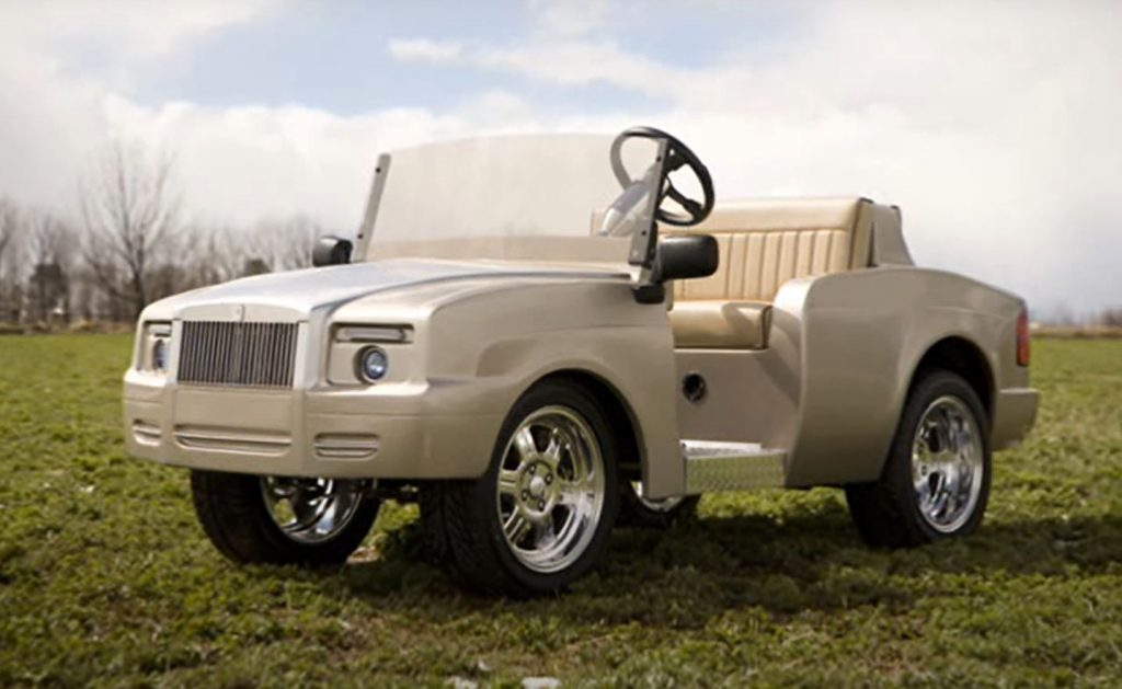 A custom gold colored Rolls-Royce Shadow golf cart
