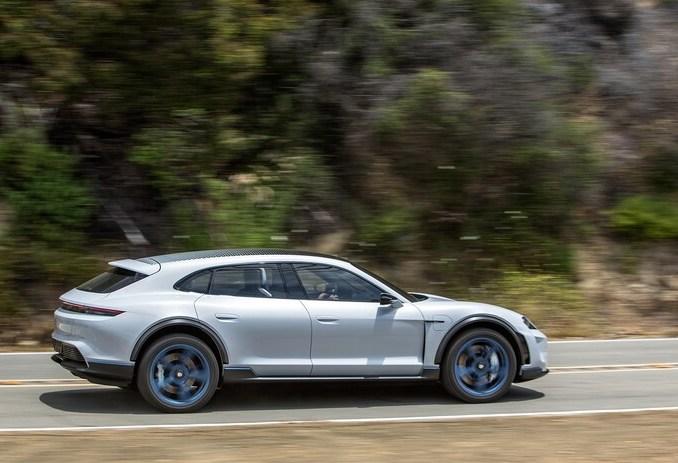 white 2021 Porsche Taycan Cross Turismo cranking down country road