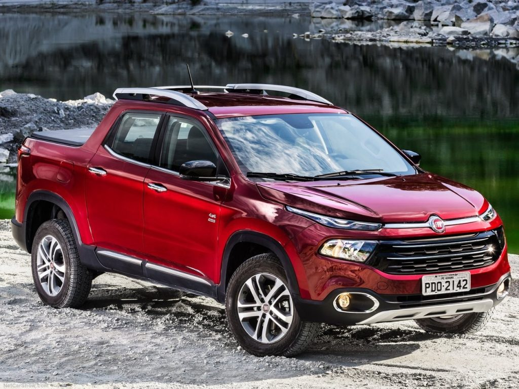 A red Fiat Toro mountainside shot. The Fiat Toro is the base for the Ram 1000