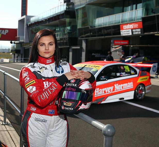 Renee Gracie poses with her racing sedan at Bathurst, Australia