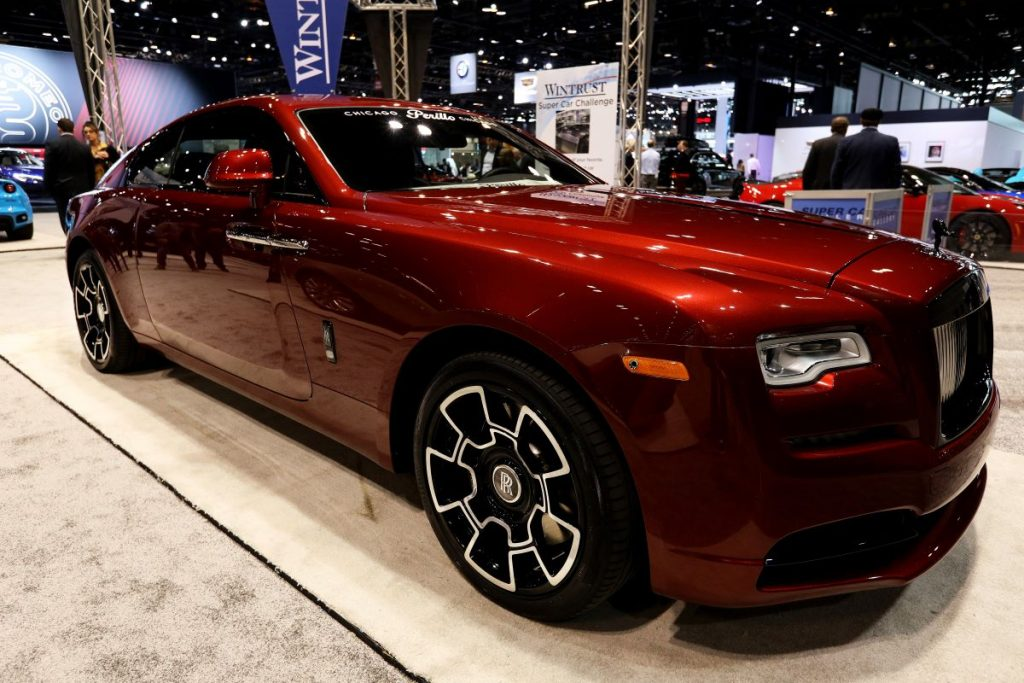 A burgundy Rolls-Royce Wraith sitting on display