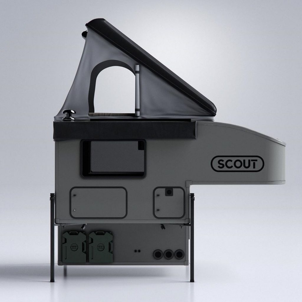Side view of an unmounted Scout Campers Olympic truck camper with tent