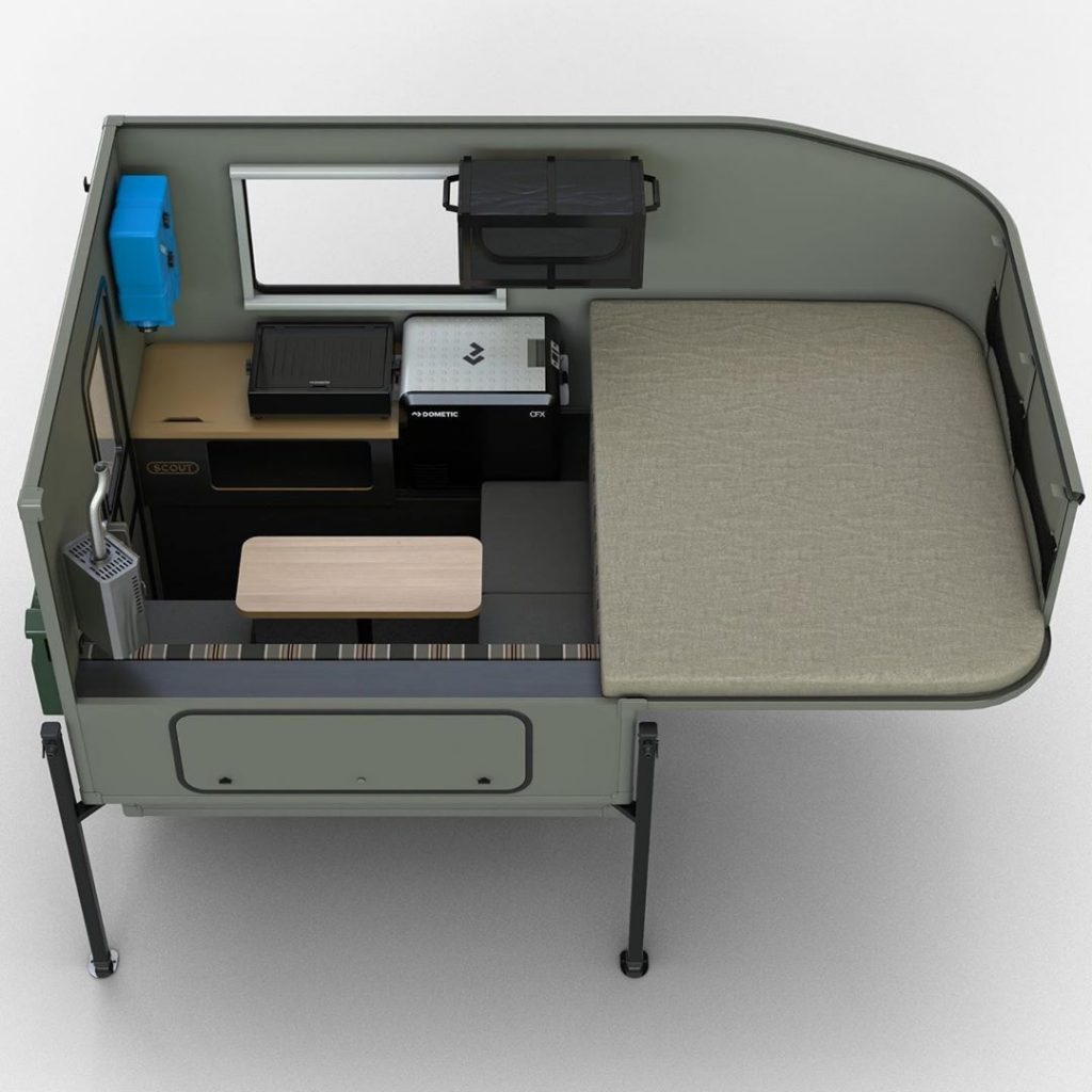 Cutaway image of the Scout Campers Yoho, showing the sleeping area, as well as the optional fireplace and cooktop