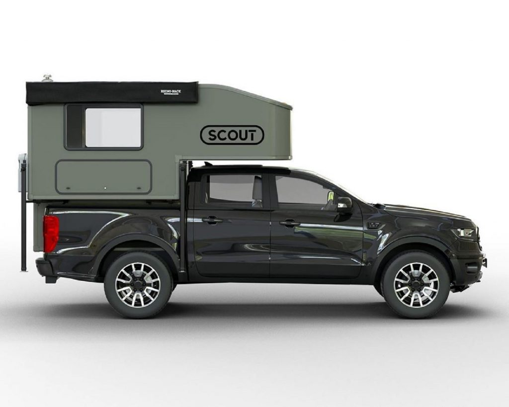 Green Scout Campers Yoho on a black Ford Ranger, viewed from the side
