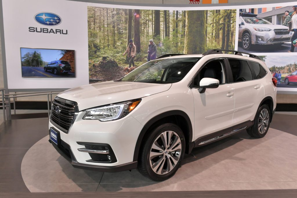 A white Subaru Ascent on display at an auto show