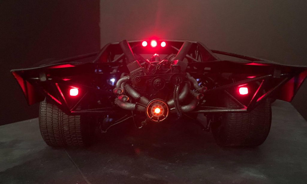 The Batman Batmobile 2021 rear view with glare from red lights showing engine| Frost