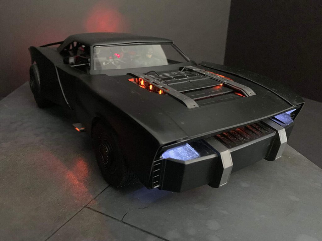 The Batman Batmobile 2021 | front 3/4 view with headlights on Frost