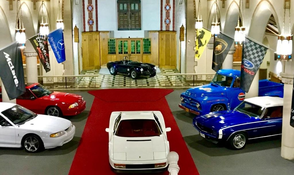 Cars are parked inside an old church