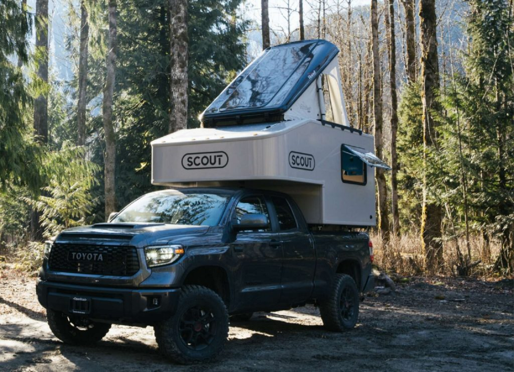 Green Toyota Tundra with Toyota Tundra with Scout Campers Olympic truck camper mounted in the bed