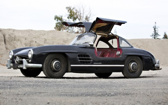 Black unrestored 1956 Mercedes-Benz 300SL Gullwing with its doors up