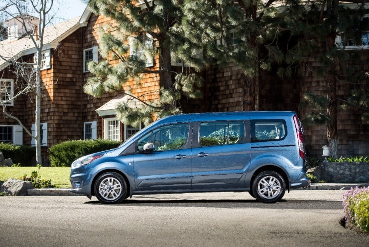side view of a blue ford transit connect