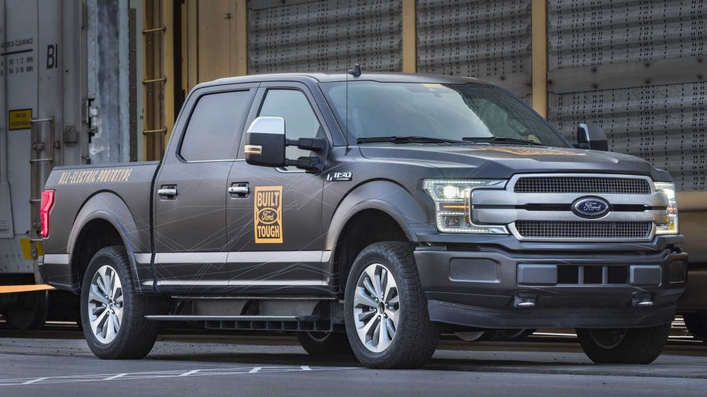 Ford F150 prototype EV in front of train