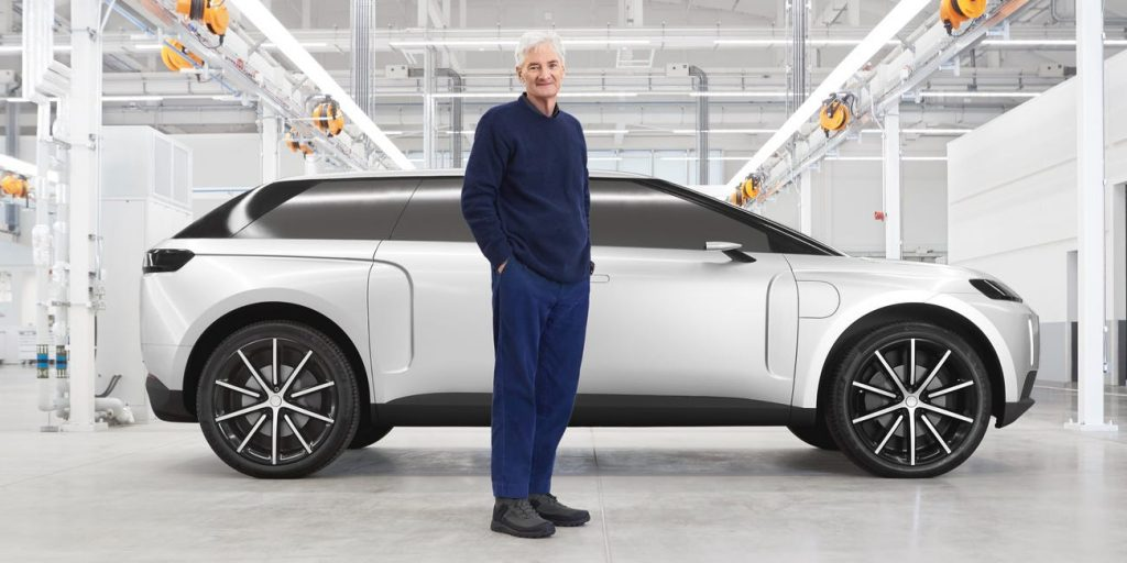Sir James Dyson standing beside his electric SUV | Dyson