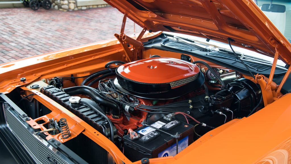 The hood is raised to reveal the 426 Hemi in this Dodge Challenger