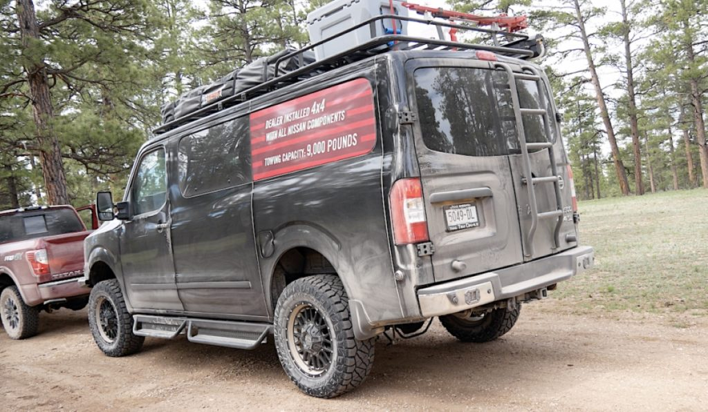 Pic of the rear of an overlanding conversion on a Nissan van