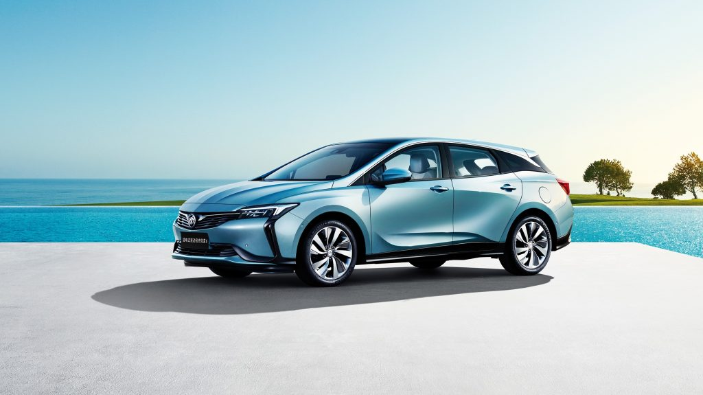 Electric light blue Buick Velite 6 PHEv parked by the ocean.