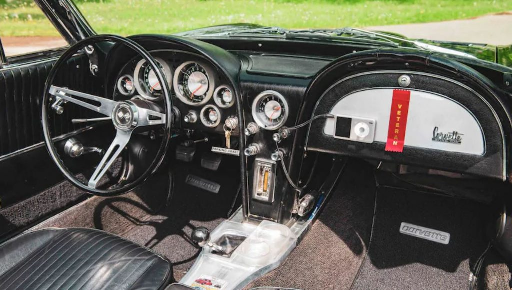 This view is of the black interior of the black 1963 Corvette.