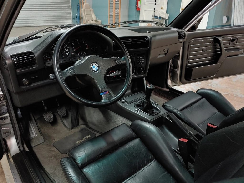 The dashboard and front Recaro seats of a 1988 BMW E30 M3