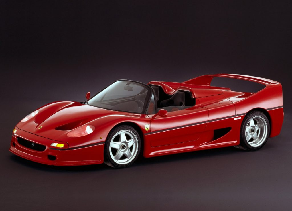 A red 1995 Ferrari F50 with its targa roof off