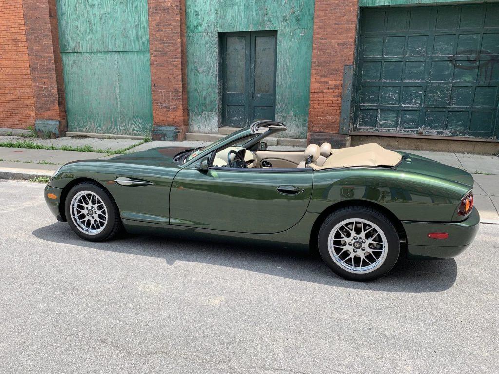 The side view of a green 2001 Panoz Esperante convertible