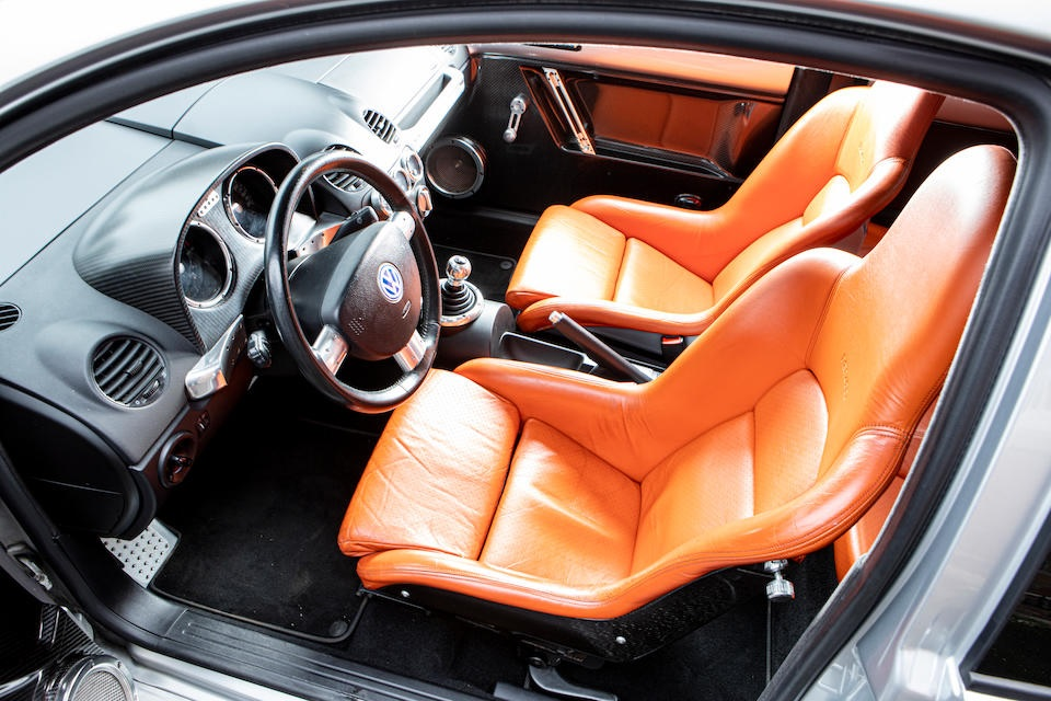 An interior shot of the 2001 Volkswagen Beetle RSI, showing the tan leather seats and carbon-fiber trim