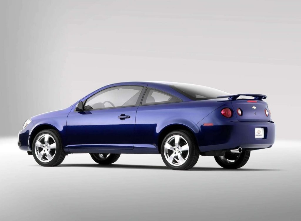 A rear-3/4 view of a blue 2005 Chevrolet Cobalt coupe