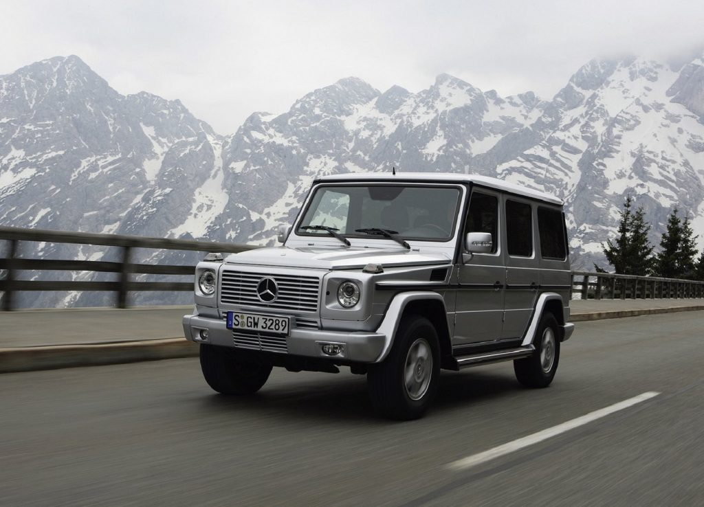 A silver 2007 Mercedes G550 G-Wagon drives on a mountain road