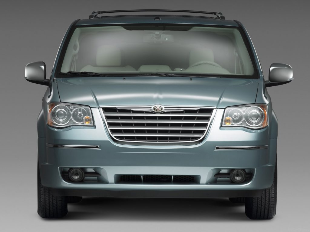 A head-on view of a mist blue Chrysler Town and Country