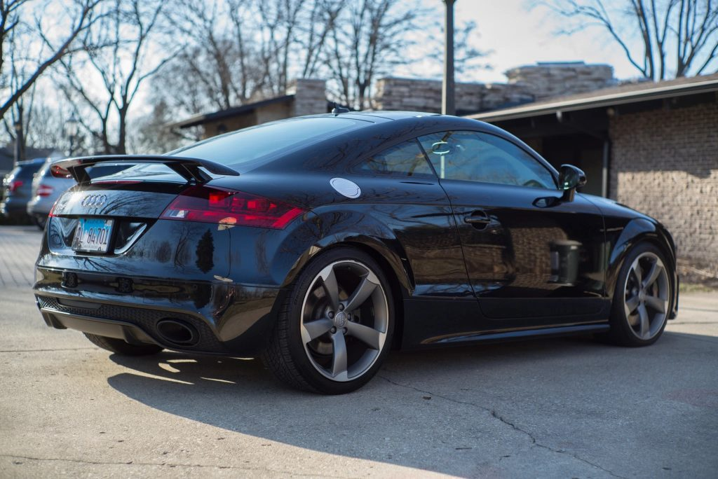 Rear view of a black 2012 Audi TT RS Coupe