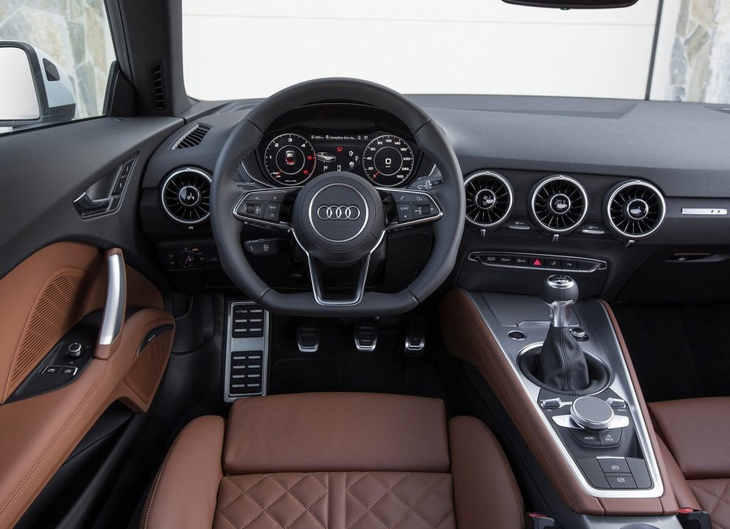 An interior shot of the 2015 Audi TT Coupe's interior, showing brown leather and a black dashboard