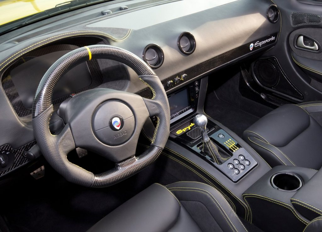 The black-with-yellow-stitching interior of the 2015 Panoz Esperante Spyder GT