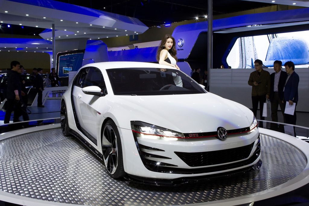 Models pose next to a 2015 Volkswagen GTI at the Seoul Motor Show