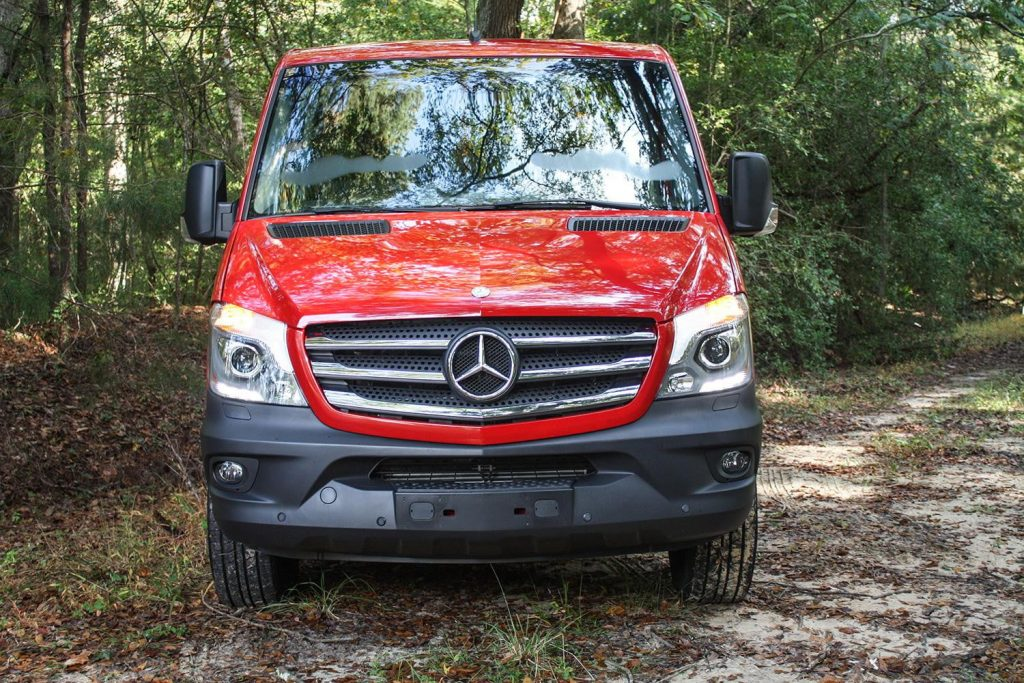 A red grille view of a 2015 model year used Mercedes Sprinter van