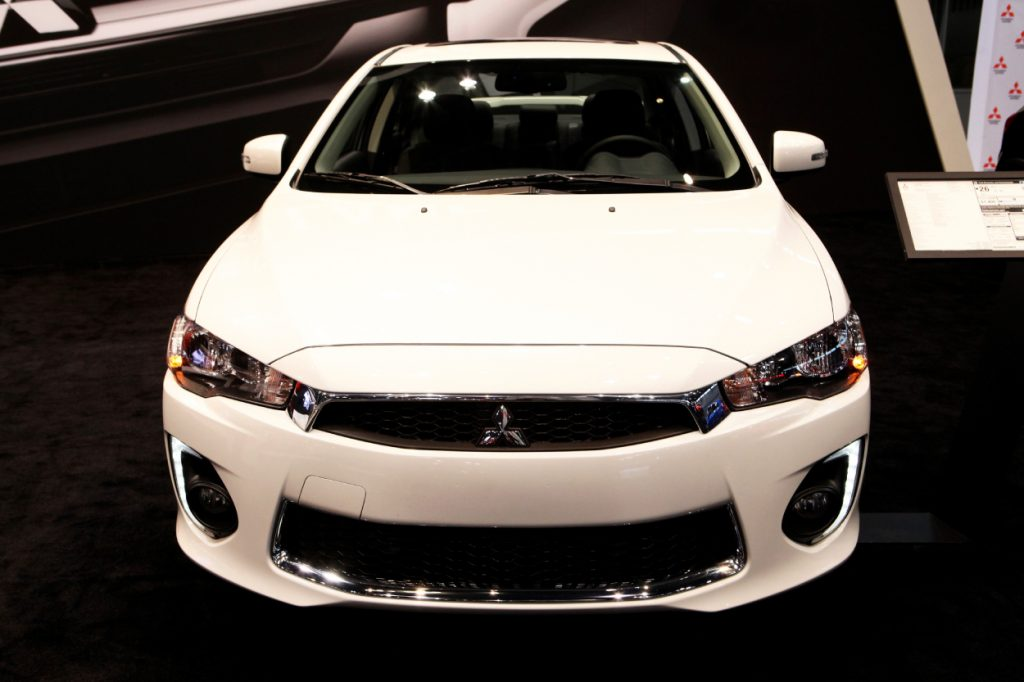 A 2017 Mitsubishi Lancer on display at an auto show