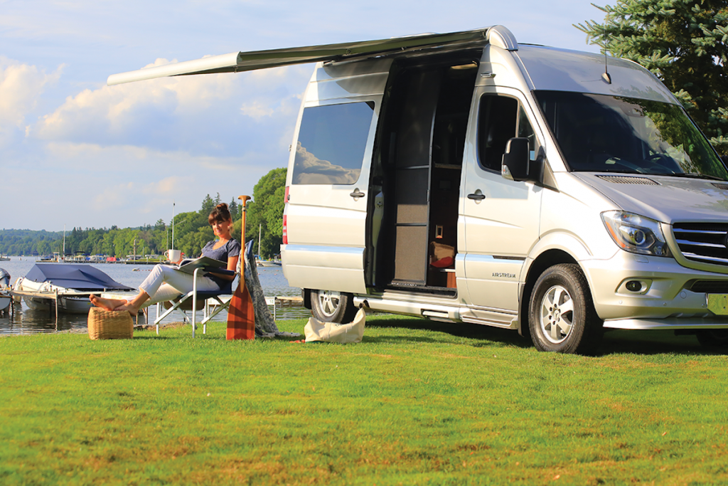 The 2019 Airstream Interstate 19 model camped out on a soft grassy plain
