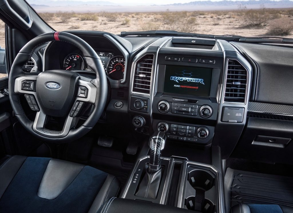 Interior shot of the 2019 Ford F-150 Raptor, showing blue-insert seats