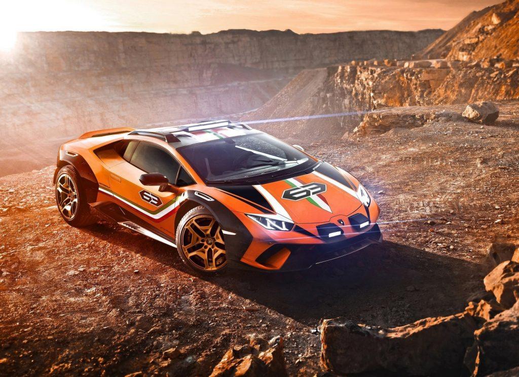 Orange and Tricolore-striped 2019 Lamborghini Huracan Sterrato concept parked overlooking a desert canyon