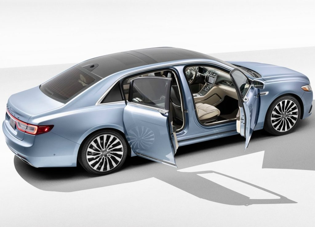 A light-blue 2019 Lincoln Continental 80th Anniversary Edition sedan with its front and rear-hinged rear doors open