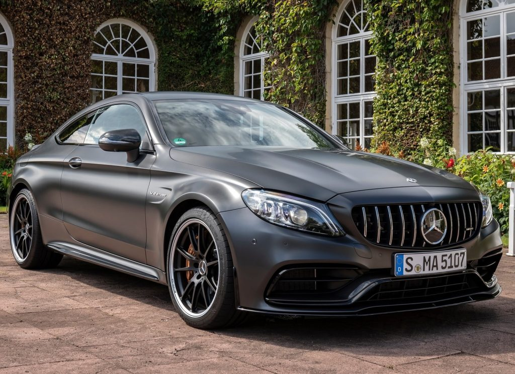 A matte-gray 2019 Mercedes-AMG C63S coupe in front of an ivy-covered building