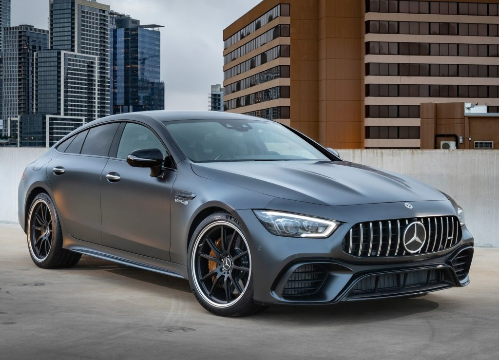 A matte-gray 2019 Mercedes-AMG GT63 S parked on the top level of a city parking garage