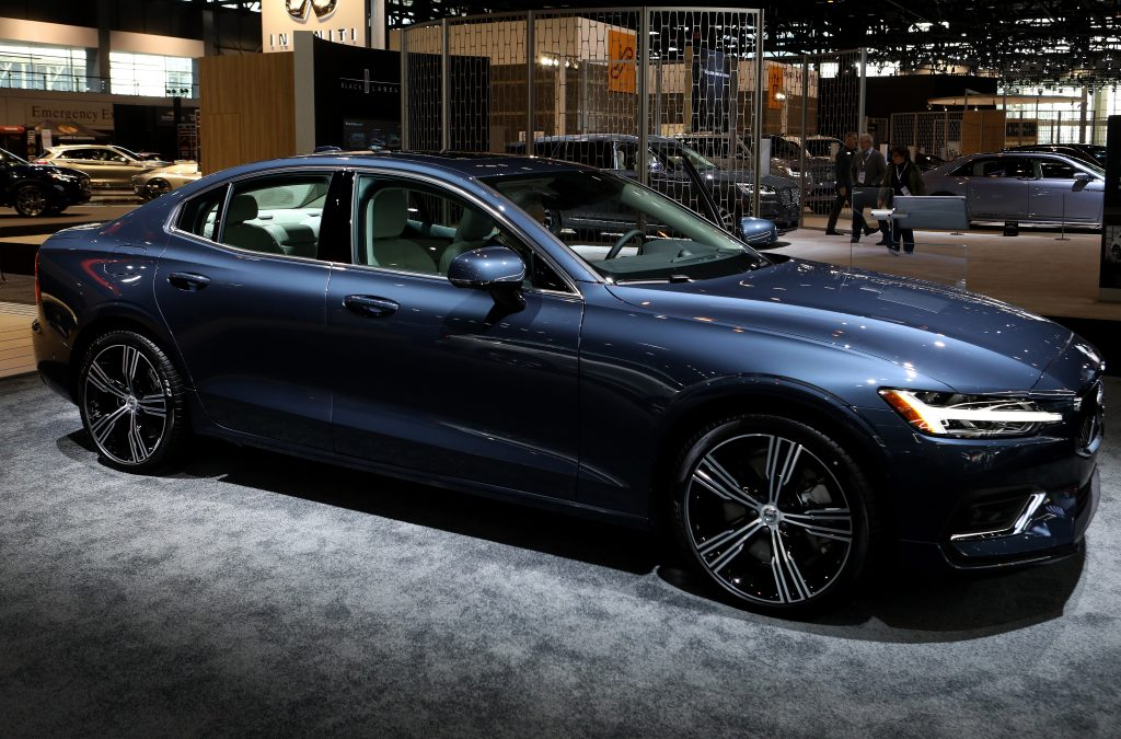 A blue 2019 Volvo S60 sits on display at a car show.