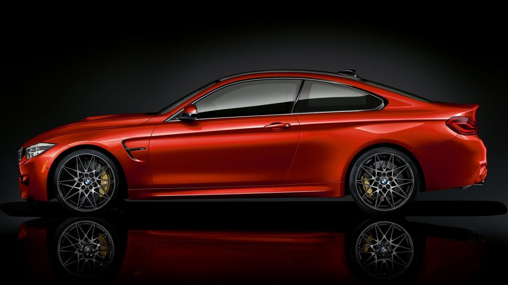 Side view of an orange 2020 BMW M4 coupe