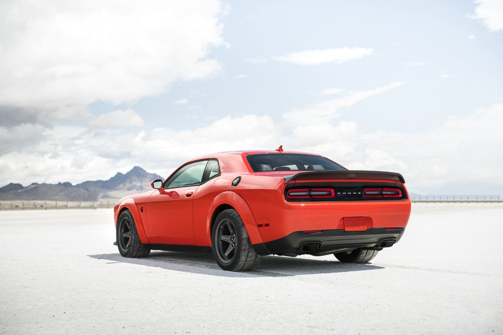 The rear of the red 2020 Dodge Challenger SRT Super Stock on a dry desert lakebed