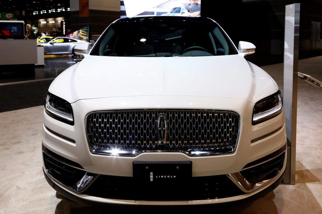 The front of a white 2020 Lincoln Nautilus SUV