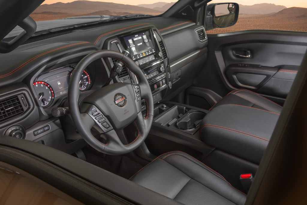 The black-and-red-trimmed interior of the 2020 Nissan Titan Pro-4X