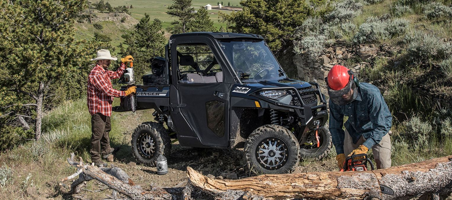 two ranchers clearing deadfall with a Polaris Ranger XP 1000 UTV