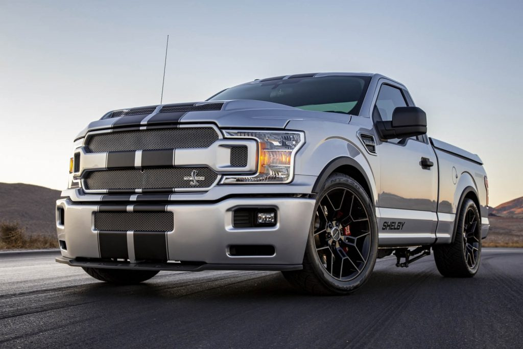 Silver-with-black-stripes 2020 Shelby F-150 Super Snake on a racetrack