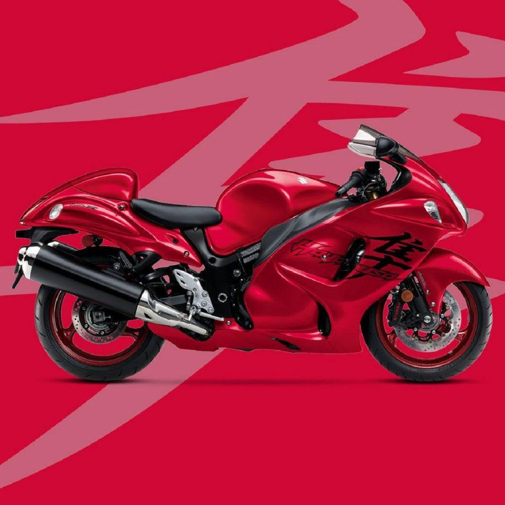 A red 2020 Suzuki Hayabusa against a lighter-red 'Hayabusa' kanji background